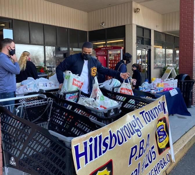 Supermarket Shoppers Eager to Help Hillsborough Police Stuff the Bus