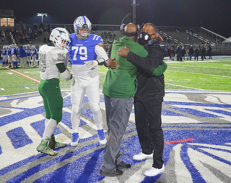 The Holman brothers embrace before the game.