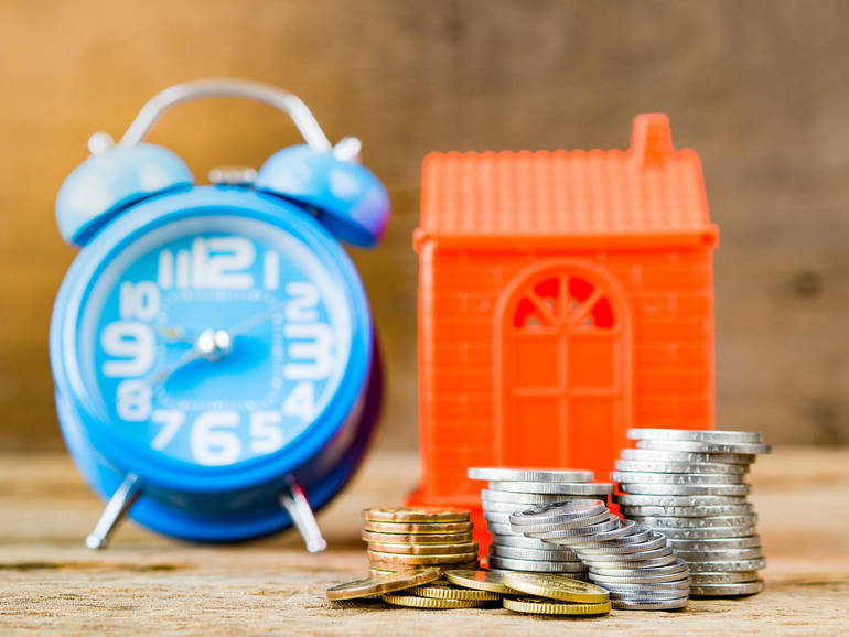 home clock money wait to buy home.jpg