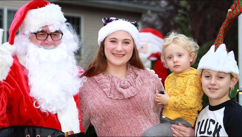 Santa visits Scotch Plains Home Decorating Contest participants.