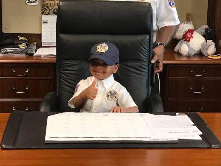 Honorary Sheriff Diaz sitting at Sheriff Cureton's Desk.jpg
