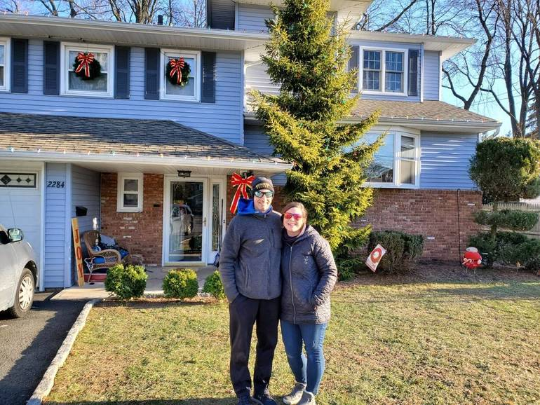 Joe and Bethany Rodrigues were surprised to have been chosen to have their home in Scotch Plains decorated for the holidays.