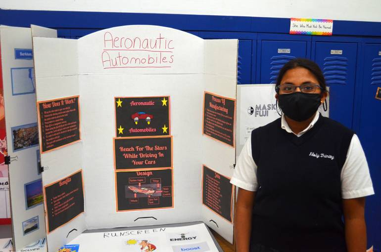 Anna Maliakal of Holy Trinity shows her flying automobile designs