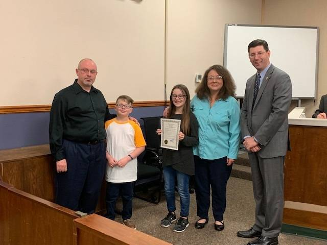 Vivian and Robert Springfield and their children, Mary and Logan with Mayor Anesh