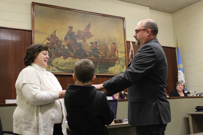 Jeremy Long is sworn in.