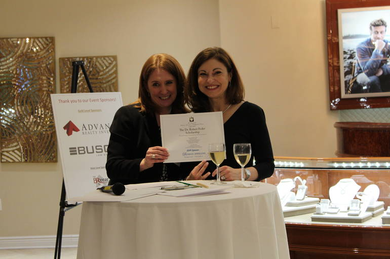Stacey Kimmins with Lucy, of Roman Jewelers