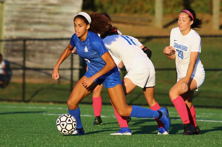 Corinne Lyght #6 of Scotch Plains-Fanwood moves the ball against Cranford