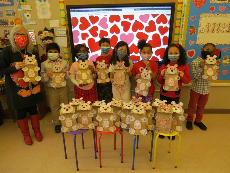 The second graders and Miss Colandrea proudly display their bear bags.
