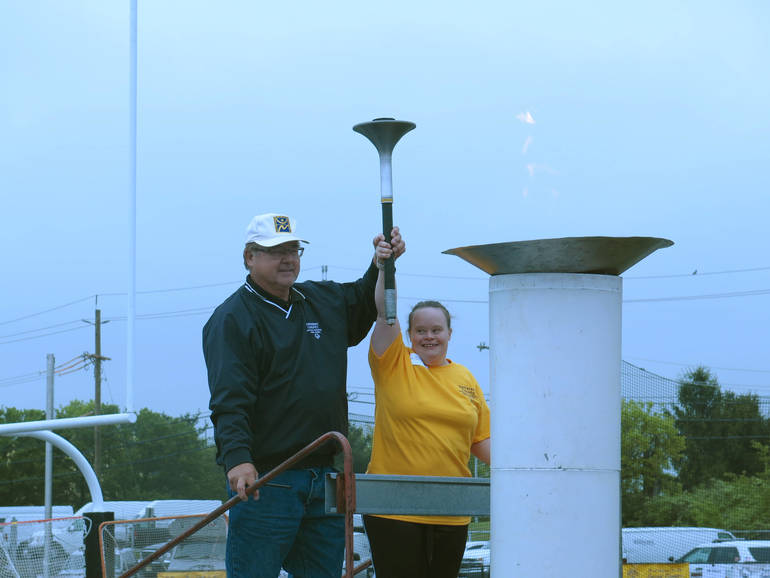 Kristen Clark led the ceremonial torch lighting to kick off the event.