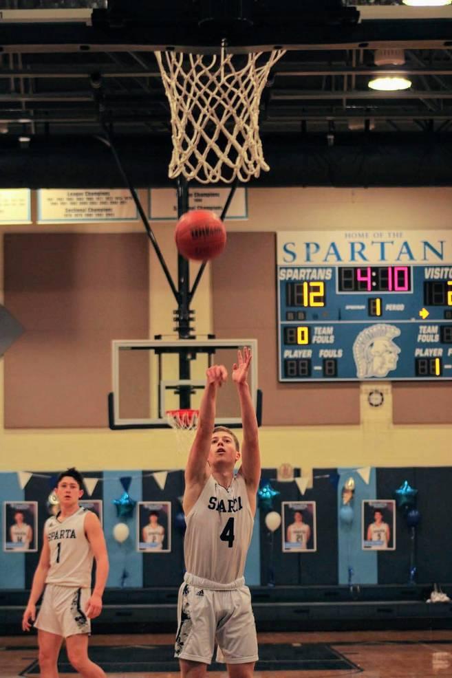 Sparta's Seniors Shine in Dominant Win over Pope John on the Basketball Court