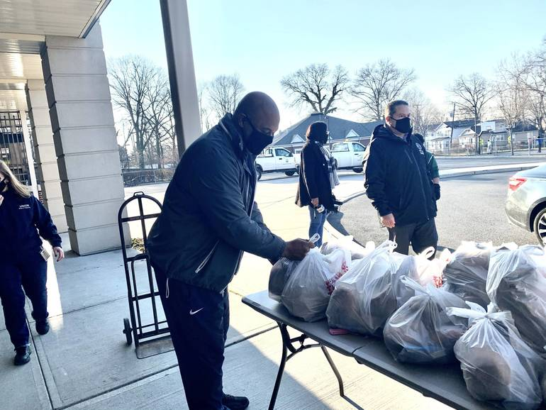 MTN Organization Helps Those In Need with Food Giveaway at Jefferson School