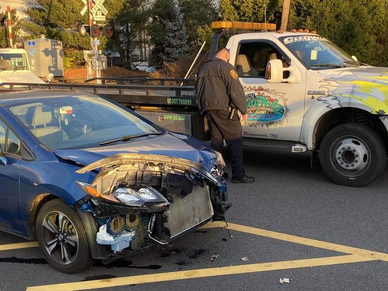 Motorist Ticketed in Glen Rock After Front of Car Ripped Off by Train