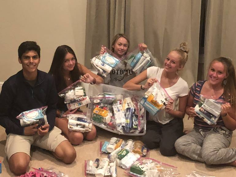 Students Making Monthly Toiletry Bags for Mobile Showers