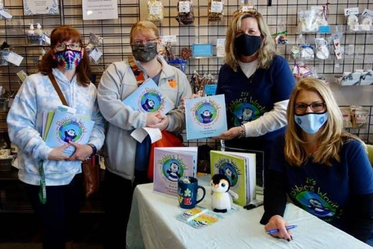'Robbie's World' Author Signs Books During Autism Awareness Month