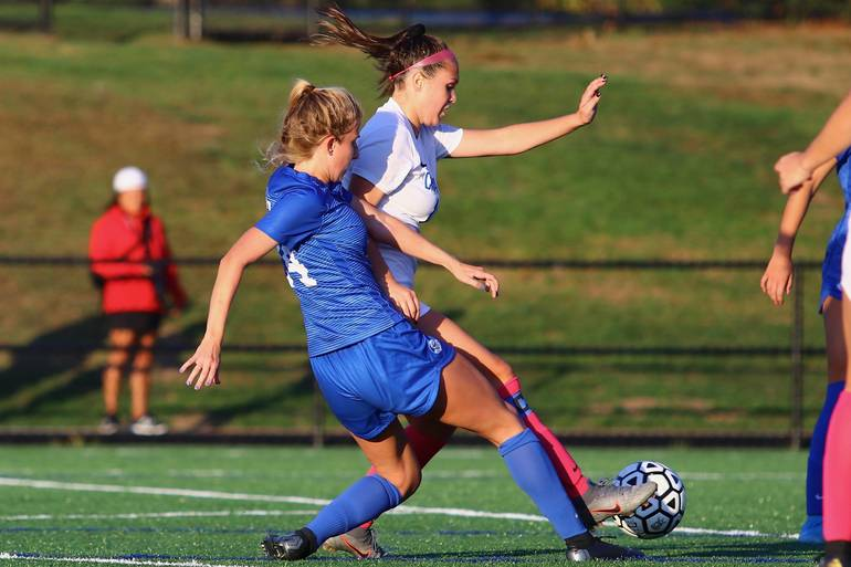 Lizzie Ley #24 of Scotch Plains-Fanwood competes for a ball against Cranford