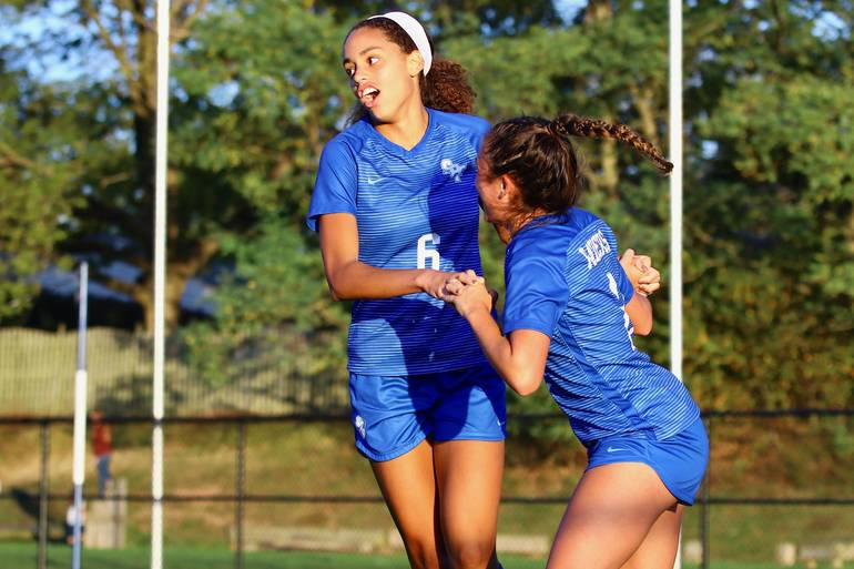 Corinne Lyght #6 is congratulated by Faith Price #2 of Scotch Plains-Fanwood