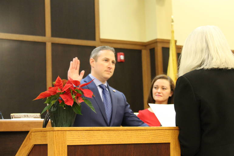 Matthew Moench is sworn in as mayor.