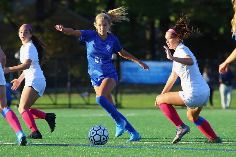 Leah Klurman #21 of Scotch Plains-Fanwood defends against Cranford