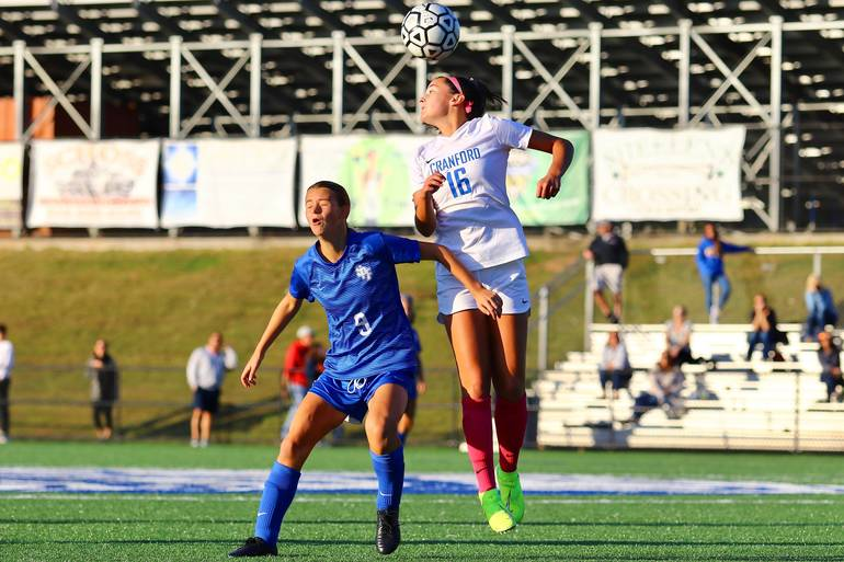 Sophia Montague #16 of Cranford and Alexa Fazio #9 of Scotch Plains-Fanwood compete for a header