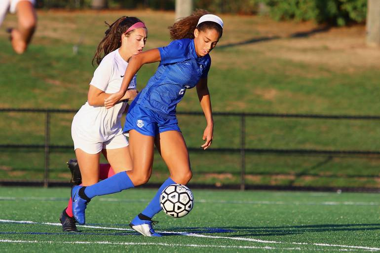 Corinne Lyght #6 of Scotch Plains-Fanwood scores the game-winner against Cranford