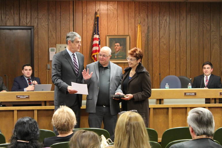 Don Tozzi is sworn in as council president.