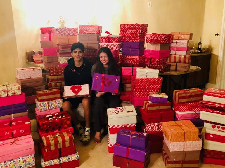 Charlie and Alexa with Their Boxes of Love