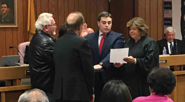 Councilman Nicolas Carra is sworn in.