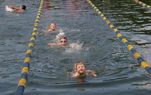 Roxbury Swimmers Pound Out Laps to Help Social Services