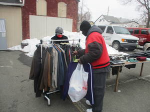 Refuge in a Storm: With Clothing Giveaway St. Luke's, Christhouse Continue Providing a Community in Need