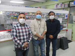 Brothers Eyad and Khalid Bader with Amet Patel at Paterson's Pharmacy Plus & Surgical Supplies.