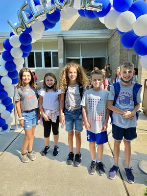 Hehnly Students Enter Custom Arches as They Headed Back to School