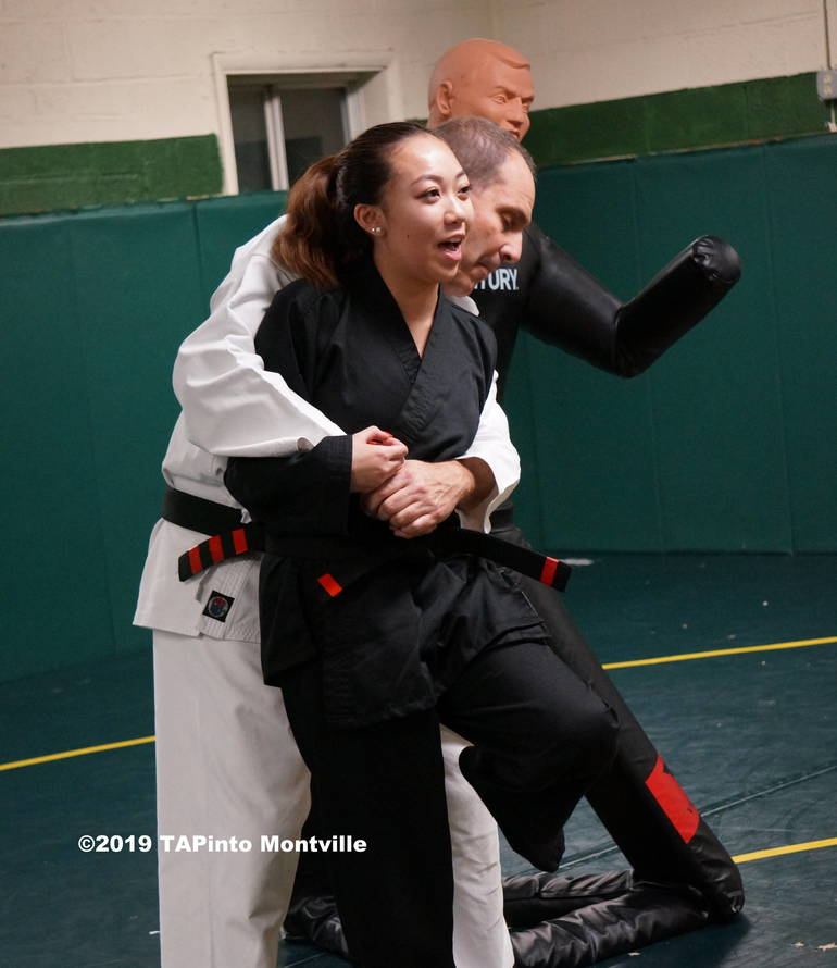 Instructor Skylar Lee lands a painful stomp on sensei Eli Brickman's foot ©2019 TAPinto Montville.JPG