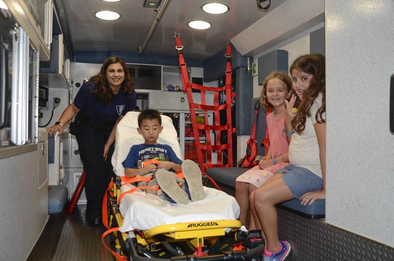 Fanwood EMT Shreya Kachroo hosts young visitors in Rescue Squad ambulance 578