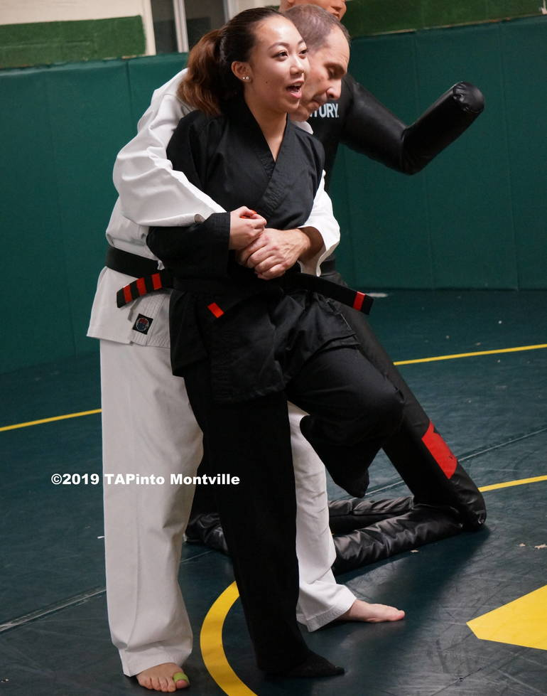 Instructor Skylar Lee lands a painful stomp on sensei Eli Brickman's foot ©2019 TAPinto Montville     crop 2.JPG