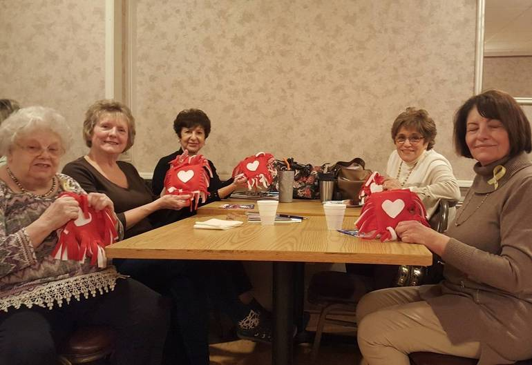 From l to r - Judy Krieg helping members Dee Stayvas, Joanne Stogoski, Elaine Bolger, and Maureen Abbruzzese with craft project