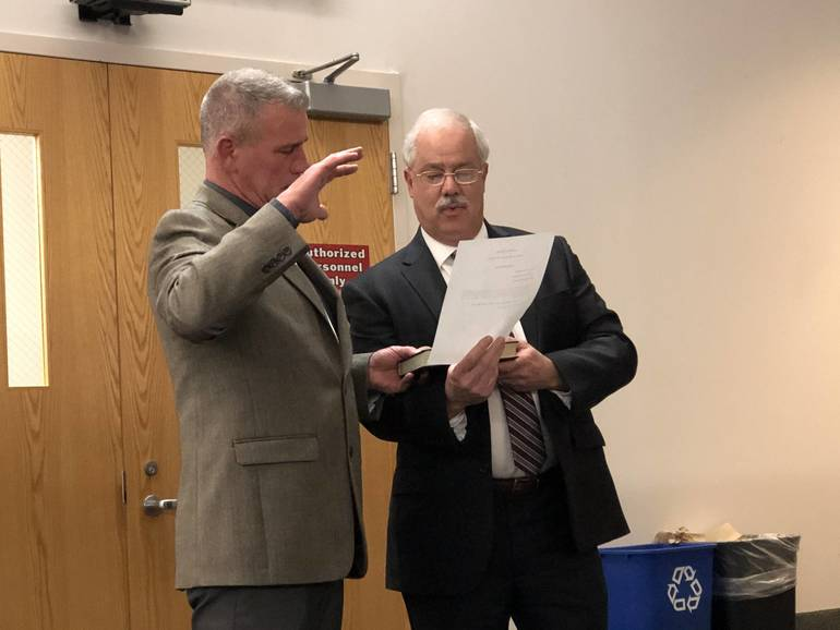 Jack Gale is sworn in by Mayor Jeff Kuhl.