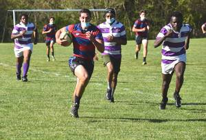 Carousel image c08e509c61bc13c05b2f jayden kass races toward the try zone for a score 5 12 21