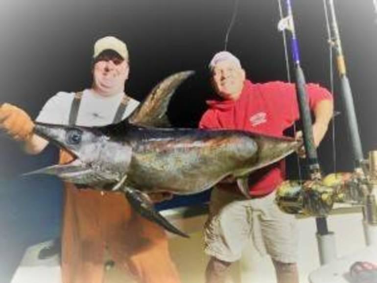 jim Hutchinson sr and swordfish.jpeg