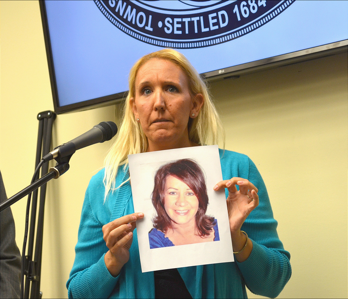 Jill Pall holds up photo of a friend who died of Ovarian Cancer at Scotch Plains Township meeting.