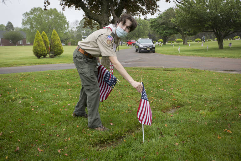 Troop 104 Scouts Place Flags
