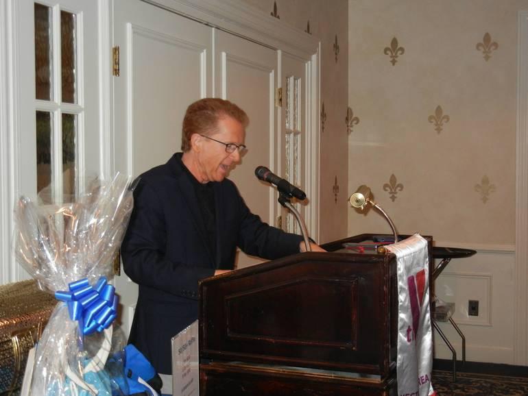 John Elliiot returns as celebrity auctioneer.jpg