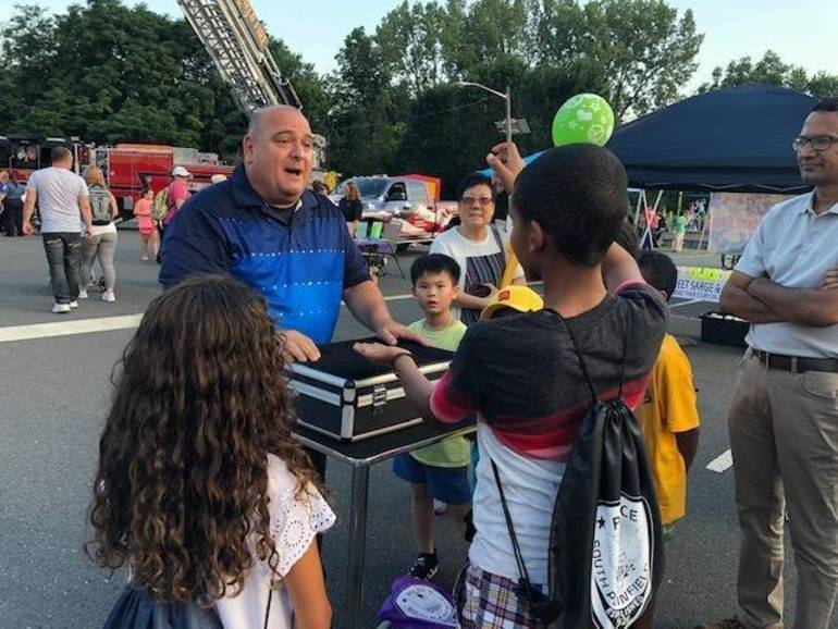 Joe Fischer entertaining children NNO 2019.jpg