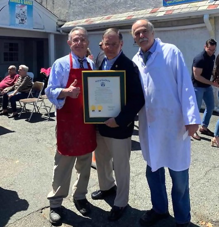 Assemblyman Jon Bramnick presents a resolution from the NJ Assembly to Vinnie and Nick Losavio of John's Meat Market in Scotch Plains.