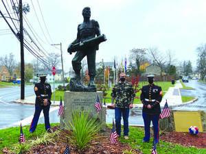 Marines Spread Iwo Jima Sand at Basilone Memorial