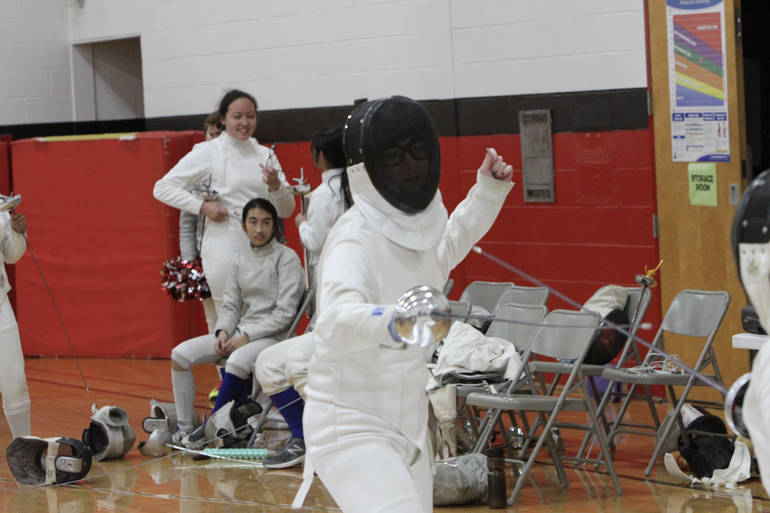 Junior epee Holly Coviello going for the win on her birthday at West Essex.jpg
