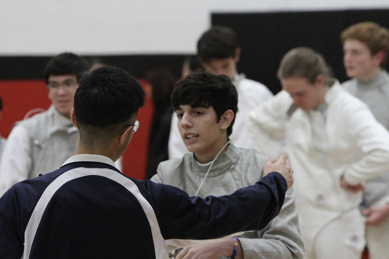 Junior saber Jayson Cantor encouraged by Coach Wang before a win at West Essex.jpg