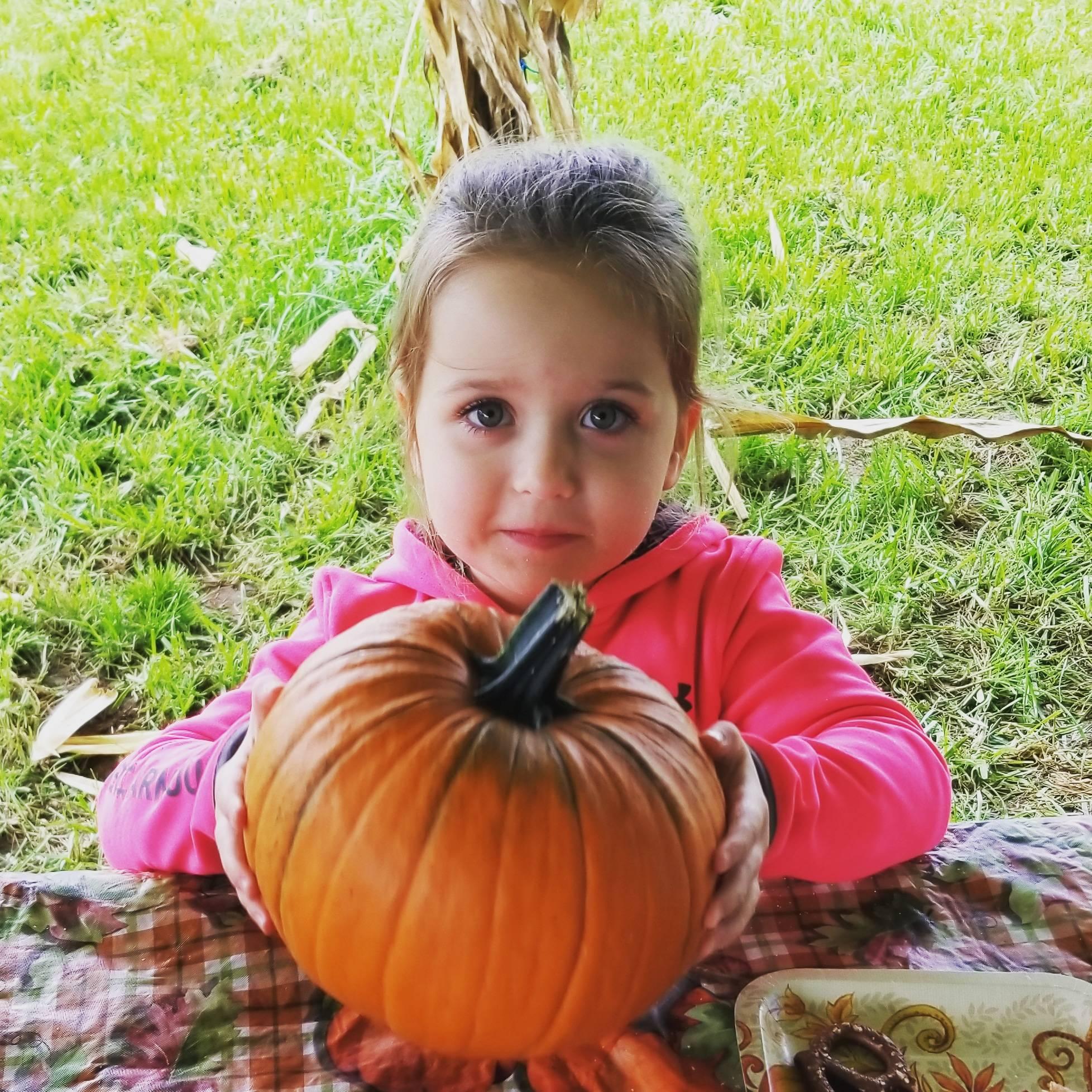Katherine with pumpkin.jpg