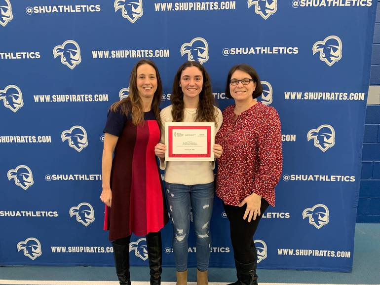 kaitlyn cumiskey with coach henry and her mom.jpeg