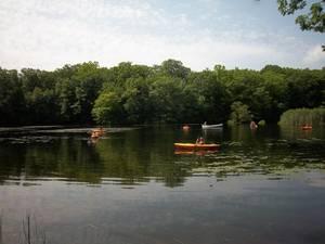 Carousel image b5c937a24ad9ee902f4e kayaks on lake