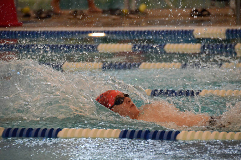 Kyle Beebe swimming back